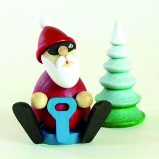 Weihnachtsmann mit Schneerutscher H 8,3 cm & verschneitem Baum H 8,0 cm